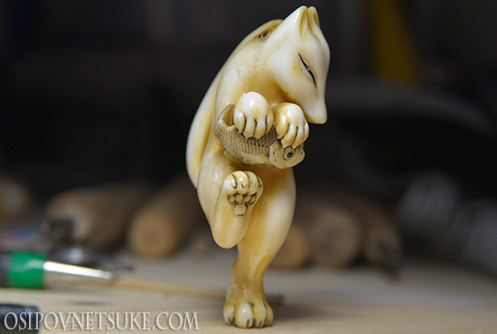 The Happy Dancing Fox with the Fish Netsuke
